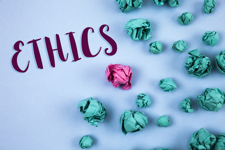 Conceptual hand writing showing Ethics. Business photo text Maintaining equality balance among others having moral principles written Plain Blue background Paper Balls next to it. 스톡 콘텐츠
