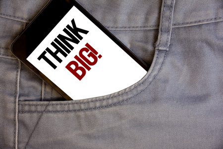 Writing note showing  Think Big Motivational Call. Business photo showcasing Have great ideas Dream of something amazingConcept on cell phone on jean pocket white screen black and red letters 版權商用圖片