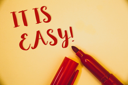 Handwriting texts It Is Easy Motivational Call. Concept meaning Clear Simple Not complicated Basic EffortlessIdeas messages words red letters created on vintage background open pen Imagens