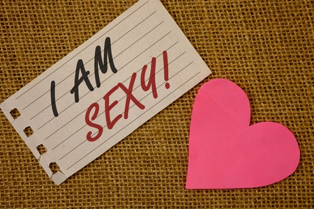 Text sign showing I Am Sexy Motivational Call. Conceptual photo Feeling of attraction Awareness of beautyNotebook page Wicker background Pink Heart Black Red letters Love note Stock Photo