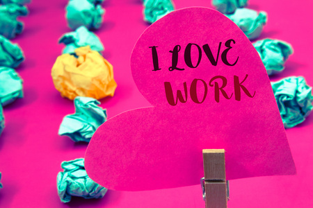 Words writing texts I Love Work. Business concept for To be happy satisfied with job Be doing what you most likeClothespin hold holding pink heart with ideas words several crumpled papers