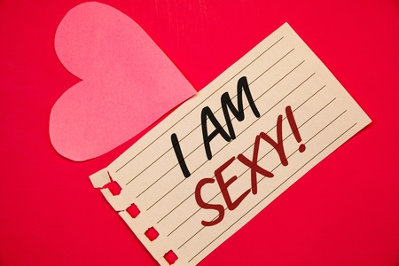 Text sign showing I Am Sexy Motivational Call. Conceptual photo Feeling of attraction Awareness of beautyNotebook page red background Pink Heart Black letters Love note romantic