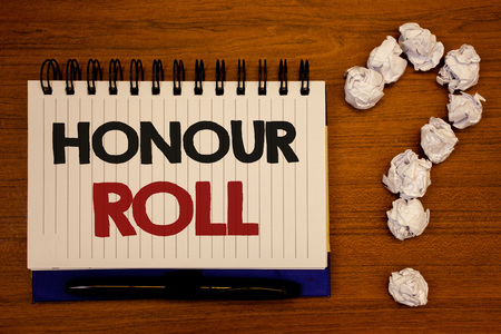 Text sign showing Honour Roll. Conceptual photo List of students who have earned grades above a specific averageIdeas on notebook wooden background quotation mark made of crumpled papers