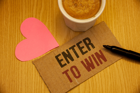 Conceptual hand writing showing Enter To Win. Business photo textss Award Reward Prize given for visiting a website Chance Giveaway Stock Photo