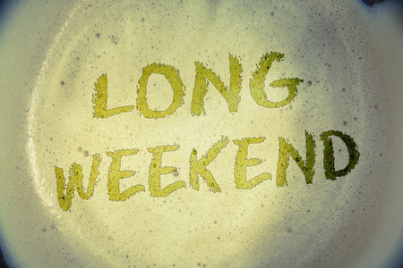 Writing note showing Long Weekend. Business photo showcasing Short vacation Holiday season Relaxing Recreation timeIdeas messages concepts words letters created foamy coffee background