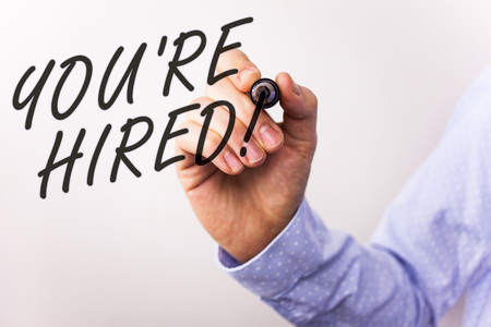 Writing note showing  You Are Hired Motivational Call. Business photo showcasing New employee recruited Worker selected