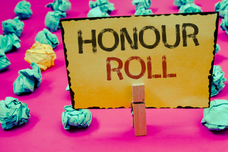 Conceptual hand writing showing Honour Roll. Business photo showcasing List of students who have earned grades above a specific averageClothespin hold holding Yellow paper ideas crumpled papers