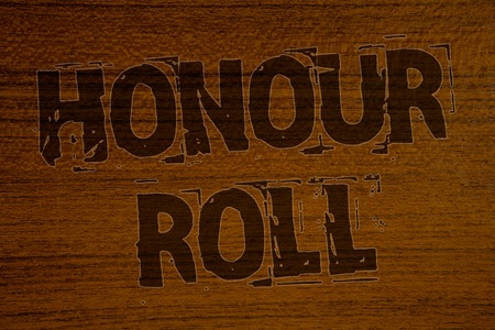 Conceptual hand writing showing Honour Roll. Business photo showcasing List of students who have earned grades above a specific averageBold brown letters words ideas on wooden background