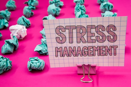 Conceptual hand writing showing Stress Management. Business photo showcasing Meditation Therapy Relaxation Positivity Healthcare Paperclip with pink letters pink ground green paper lobs