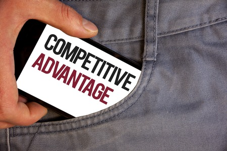 Word writing text Competitive Advantage. Business concept for owning quality that will assure you leading in field Personage hand pushing mobile phone into back pocket fascinating way