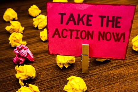 Conceptual hand writing showing Take The Action Now Motivational Call. Business photo showcasing Act Start Promptly Immediate Instantly Paperclip retrain pink card with letters wooden floor hunch Stock fotó