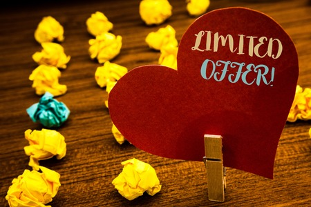 Text sign showing Limited Offer Motivational Call. Conceptual photo Short time special clearance Price Reduction Text red heart wood clip desk crumbled paper notes yellow blue love message Stock fotó