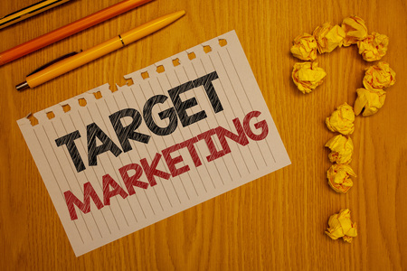 Conceptual hand writing showing Target Marketing. Business photo text Market Segmentation Audience Targeting Customer Selection Words written Note Desk Pen Pencil Question mark Crumbled paper Banque d'images - 103377093