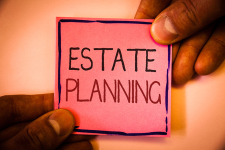 Text sign showing Estate Planning. Conceptual photo Insurance Investment Retirement Plan Mortgage Properties Man hold holding pink paper ideas black red letters frame shadow on wall Stock Photo