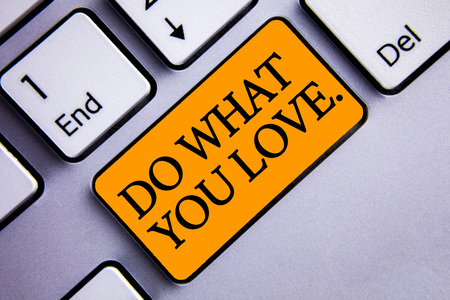 Conceptual hand writing showing Do What You Love.. Business photo text Positive Desire Happiness Interest Pleasure Happy Choice Text two words orange insert button key press grey computer