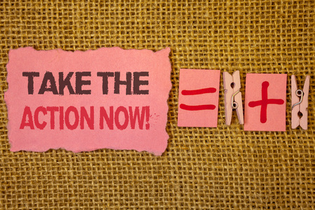 Handwriting text writing Take The Action Now Motivational Call. Concept meaning Act Start Promptly Immediate Instantly Jute sacks plus two paper clip equal pink paper with black and red letter