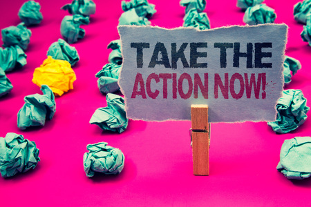 Writing note showing  Take The Action Now Motivational Call. Business photo showcasing Act Start Promptly Immediate Instantly Emerald paper balls yellow lump rosy floor paperclip retain grey page