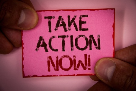 Handwriting text Take Action Now Motivational Call. Concept meaning Urgent Move Start Promptly Immediate Begin Words written pink paper note red border fingers holding corners message