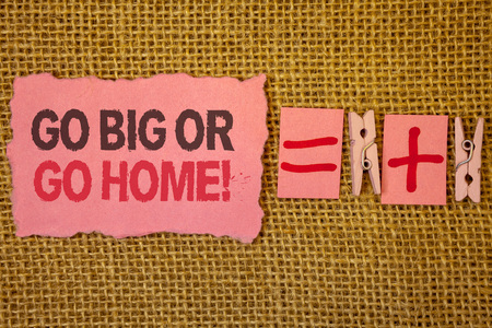 Handwriting text writing Go Big Or Go Home Motivational Call. Concept meaning Mindset Ambitious Impulse Persistence Jute sacks plus two paper clip equal pink paper with black and red letter Reklamní fotografie
