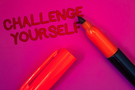 Conceptual hand writing showing Challenge Yourself. Business photo text Overcome Confidence Strong Encouragement Improvement Dare Magenta color platform dark red color tidings corner red marker Stock Photo
