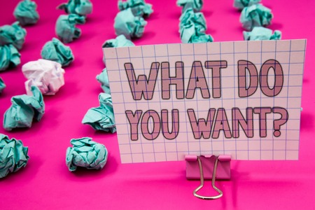 Conceptual hand writing showing What Do You Want Question. Business photo showcasing Aspiration Contemplation Need Contemplate Aspire Paperclip with pink letters pink ground green paper lobs