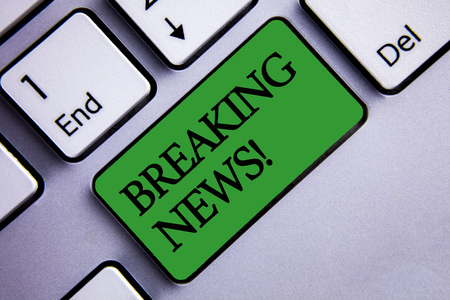 Text sign showing Breaking News Motivational Call. Conceptual photo Updated press report Latest information Text two words green insert button key press grey computer
