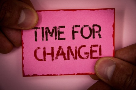 Handwriting text Time For Change Motivational Call. Concept meaning Transition Grow Improve Transform Develop Words written pink paper note red border fingers holding corners message Stock Photo
