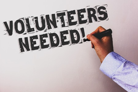 Handwriting text Volunteers Needed Motivational Call. Concept meaning Social Community Charity Volunteerism Advisors hand holding black marker whiteboard written black color words Stok Fotoğraf