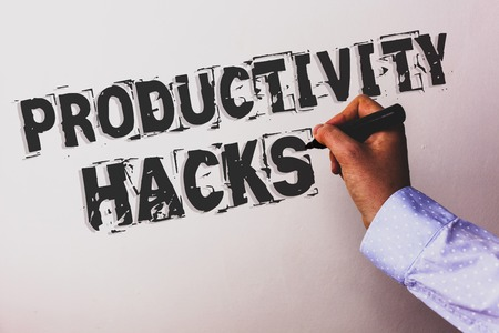 Handwriting text Productivity Hacks. Concept meaning Hacking Solution Method Tips Efficiency Productivity Advisors hand holding black marker whiteboard written black color words