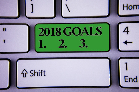Writing note showing  2018 Goals 1. 2. 3.. Business photo showcasing Resolution Organize Beginnings Future Plans Modern silvery color keyboard green button with black words arrow key Stock Photo