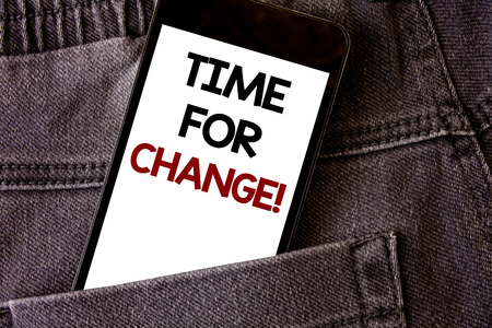 Writing note showing Time For Change Motivational Call. Business photo showcasing Transition Grow Improve Transform Develop Words written black Phone white Screen Back pocket grey jeans trousers Stok Fotoğraf