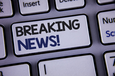 Conceptual hand writing showing Breaking News Motivational Call. Business photo showcasing Updated press report Latest information Text two words backspace button key press grey computer