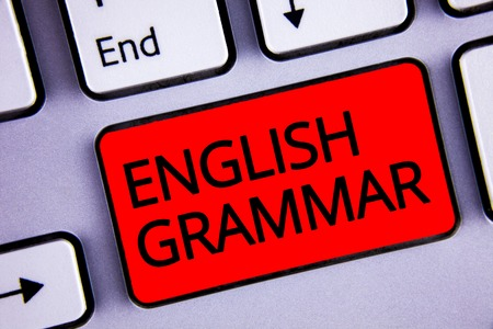 Text sign showing English Grammar. Conceptual photo Language Knowledge School Education Literature Reading Keyboard red key black letters words Intention create text on computer Banco de Imagens