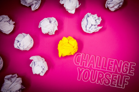 Writing note showing  Challenge Yourself. Business photo showcasing Overcome Confidence Strong Encouragement Improvement Dare Pink ground white paper lumps shadow yellow lob outline letters