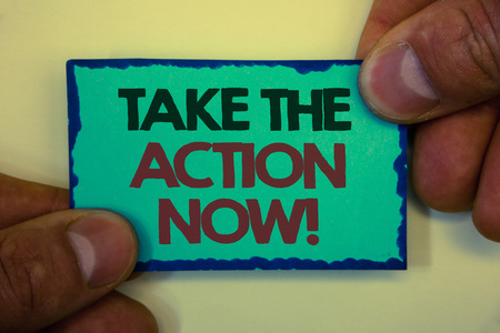 Writing note showing  Take The Action Now Motivational Call. Business photo showcasing Act Start Promptly Immediate Instantly Greyish backstage man hand retain blue outskirts page showing words