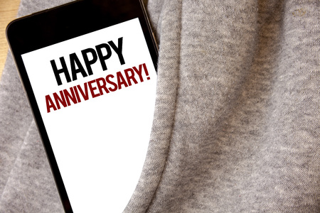 Handwriting text writing Happy Anniversary Motivational Call. Concept meaning Annual Special Milestone Commemoration Hoar frost color side pocket cell phone be visible black and red letters Banque d'images