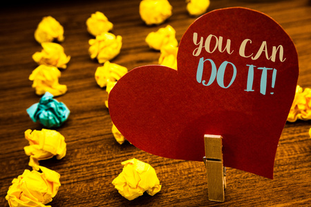 Text sign showing You Can Do It Motivational Call. Conceptual photo Inspirational Message Motivational Positive Text red heart wood clip desk crumbled paper notes yellow blue love message