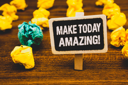 Text sign showing Make Today Amazing Motivational Call. Conceptual photo Productive Moment Special Optimistic Blackboard with letters wooden floor blurry yellow paper lumps green lob