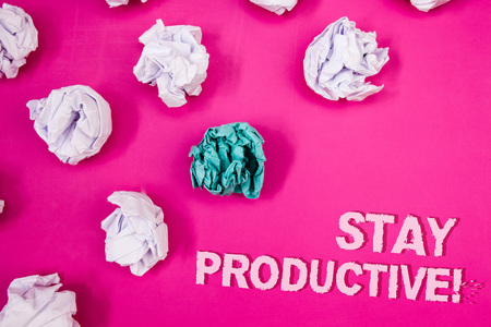 Text sign showing Stay Productive Motivational Call. Conceptual photo Efficiency Concentration Productivity Text Words pink background crumbled paper notes white blue stress angry