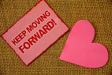 Writing note showing  Keep Moving Forward Motivational Call. Business photo showcasing Optimism Progress Persevere Move Lavender pink page with red border content pink paper heart lovely Stock Photo