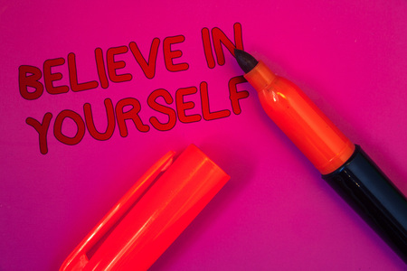 Conceptual hand writing showing Believe In Yourself. Business photo text Determination Positivity Courage Trust Faith Belief Magenta color platform dark red color tidings corner red marker