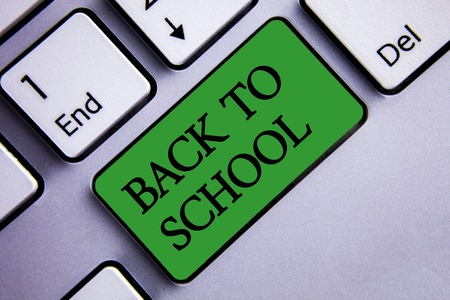 Text sign showing Back To School. Conceptual photo Return to class first day of studies Classroom Arriving Text two words green insert button key press grey computer