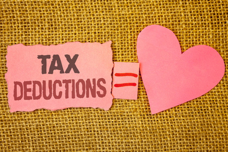 Text sign showing Tax Deductions. Conceptual photo Reduction on taxes Investment Savings Money Returns Text pink torn note equals is pink heart love message letter cute couple