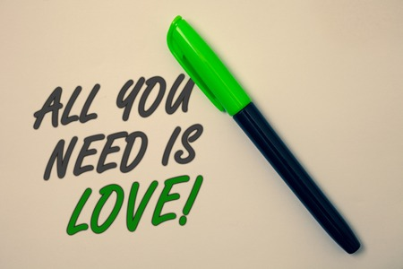 Handwriting text writing All You Need Is Love Motivational. Concept meaning Deep affection needs appreciation romance Ideas message beige background green pen pens marker markers intention