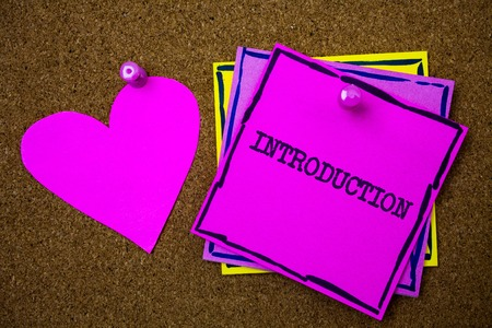 Writing note showing  Introduction. Business photo showcasing First part of a document Formal presentation to an audience Papers pink heart cork background ideas love lovely message remember