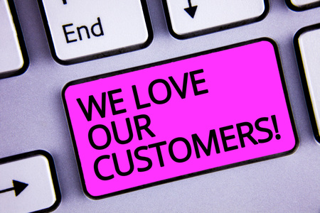 Handwriting text We Love Our Customers Call. Concept meaning Client deserves good service satisfaction respect Keyboard purple key Intention create text computer message paper essay 写真素材