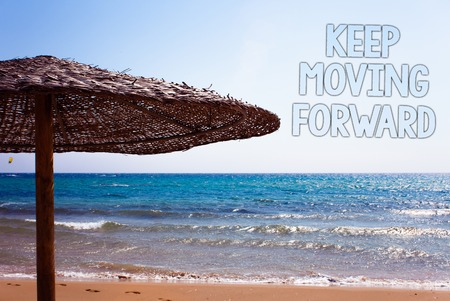 Writing note showing  Keep Moving Forward. Business photo showcasing improvement Career encouraging Go ahead be better Blue beach sand message idea sunshade water sky natural landscape