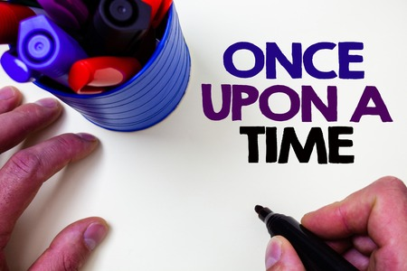 Writing note showing  Once Open A Time. Business photo showcasing telling story Fairytale story Historical event Novel Blue pen holder white background shadow lovely message idea temple