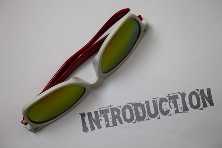Handwriting text Introduction. Concept meaning First part of a document Formal presentation to an audience Grunge ideas messages white background sunglasses inspiration idea thoughts