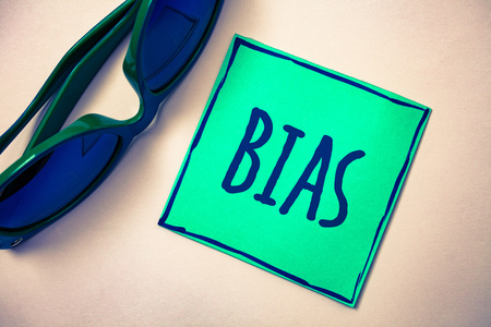 Word writing text Bias. Business concept for Unfair Subjective One-sidedness Preconception Inequality Bigotry Green paper beige background sunglasses ideas messages feelings thoughts 版權商用圖片